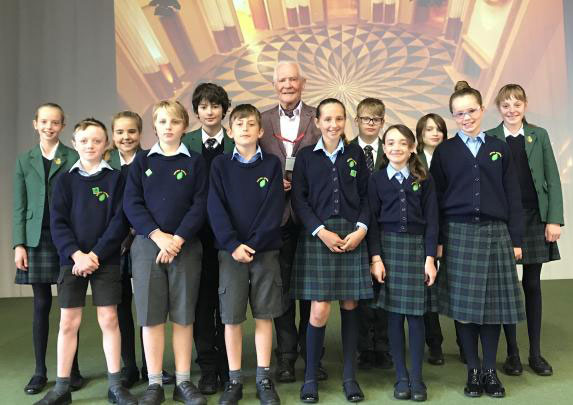 John Taylor, Inventor of the thermostat controls for the cordless kettle, with pupils from Sibford school