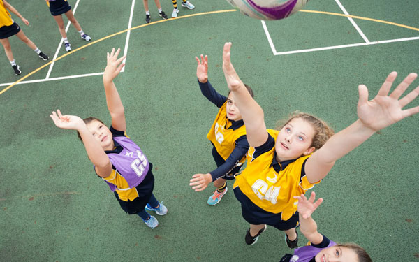 Female students from Leighton Park school playing netball