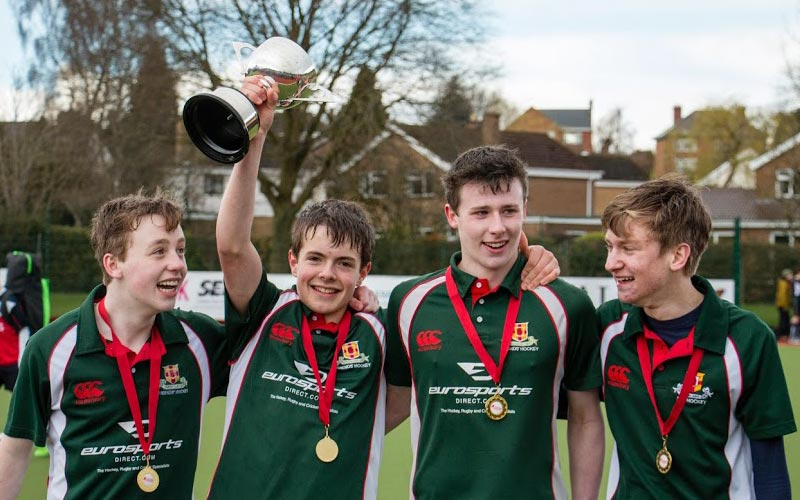 sports team celebrating their victory for the Friends' School Lisburn