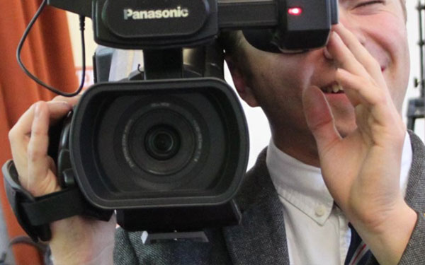 Student from Leighton Park Quaker school using a film camera