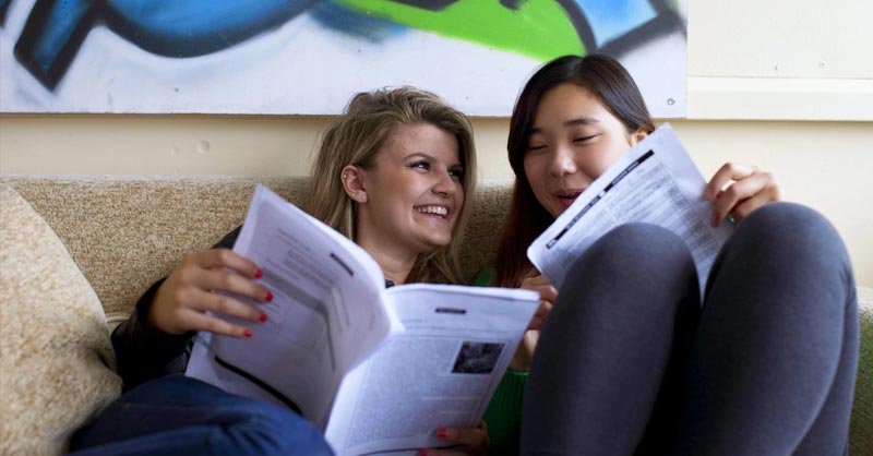 two boarding students reading together