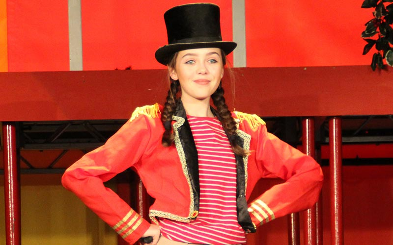 girl on stage in costume in her performance at The Mount School