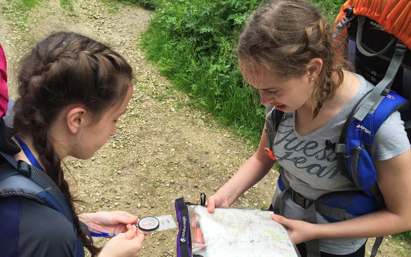 girls map reading as part of a course at The Mount School