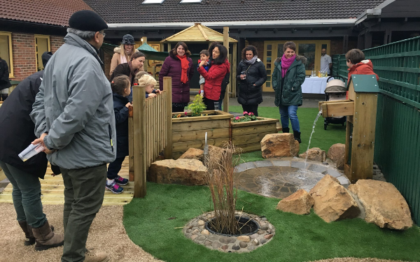 parents and children exploring the new EYFS playground at Bootham School