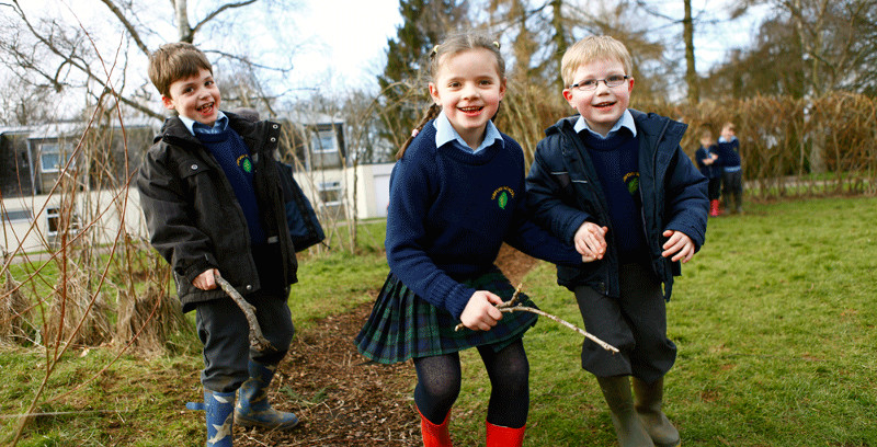 Sibford School pupils playing outdoors
