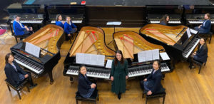 The Mount School students and music teacher in their all Steinway school