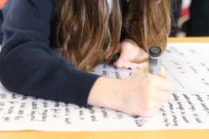 Leighton Park student writing in isolation