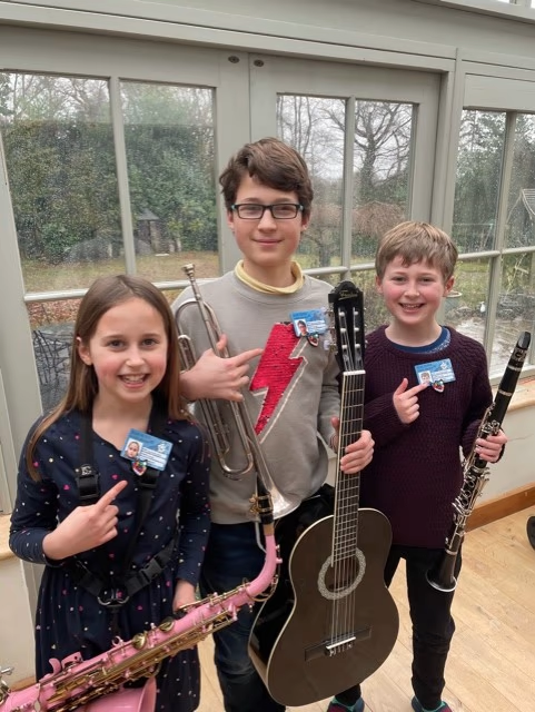 Clara, Noah and Isaac enjoying their school music lessons from home