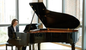 music scholar at Leighton Park School playing a piano