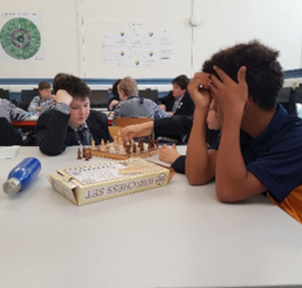 Sidcot students playing a board game